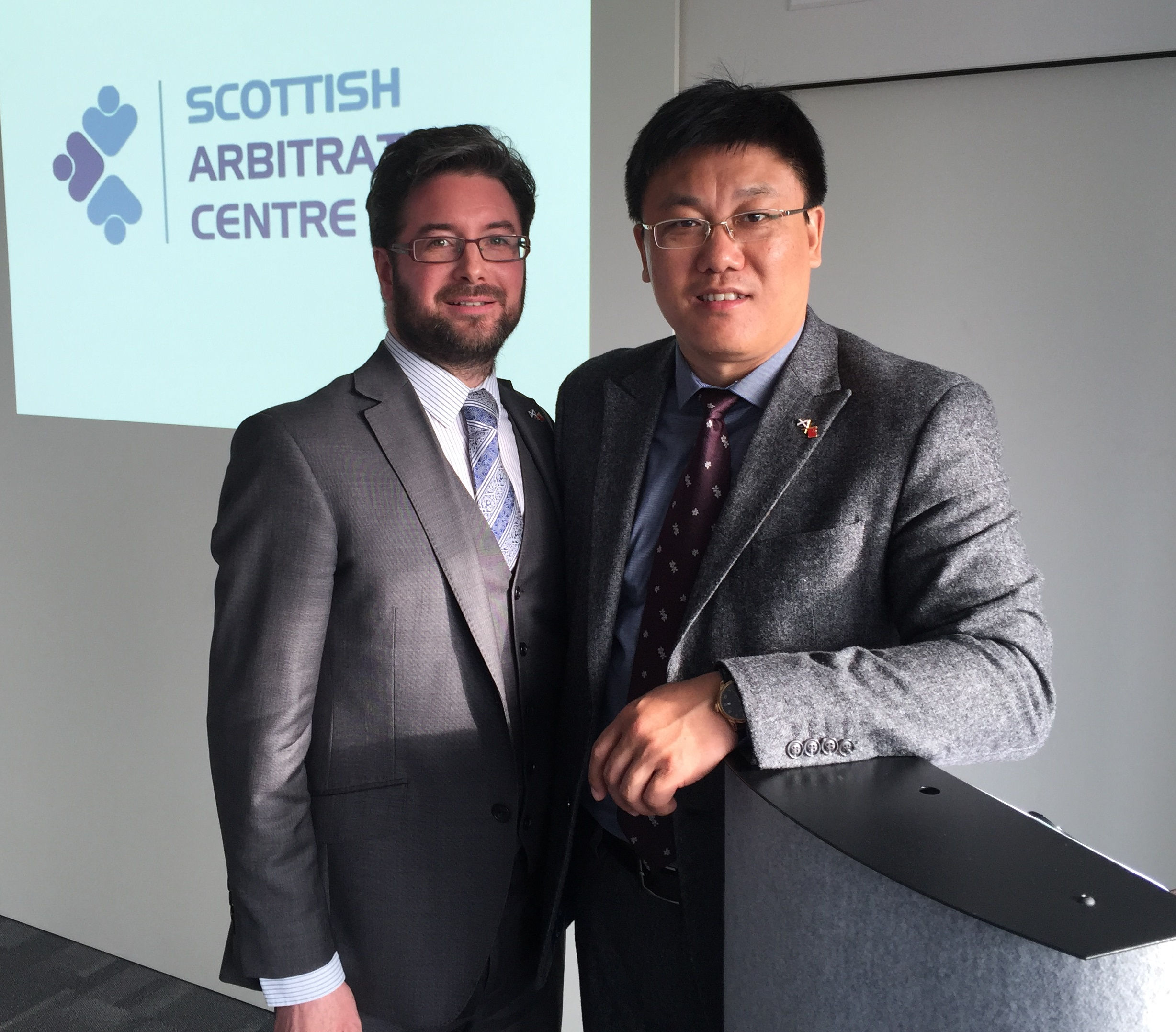 Pictured: Andrew Mackenzie, Chief Executive of the Scottish Arbitration Centre, and Lin Lin Xiaoli , Vice Director of Executive Office, of the Shanghai Municipal Development and Reform Commission.